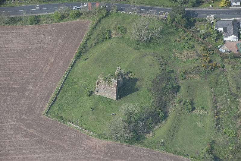 Oblique aerial view of Torthorwald Castle, looking NNW.