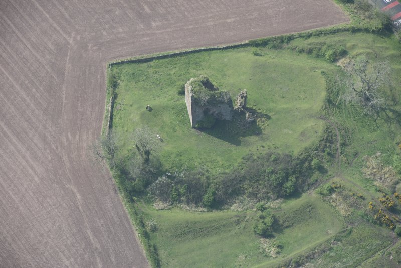 Oblique aerial view of Torthorwald Castle, looking W.