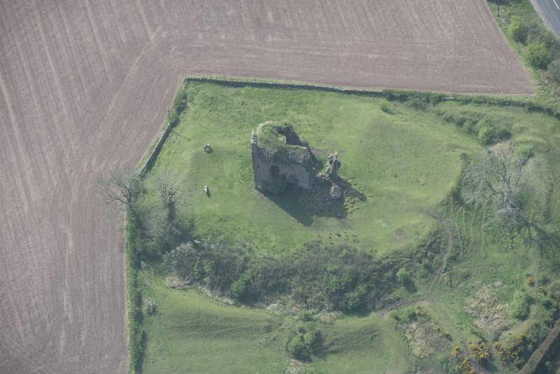 Oblique aerial view of Torthorwald Castle, looking WSW.