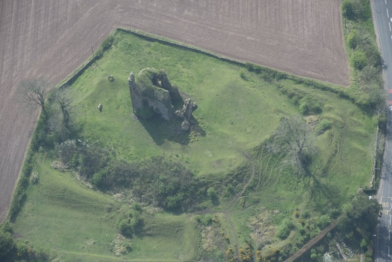 Oblique aerial view of Torthorwald Castle, looking SW.