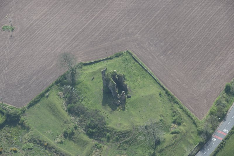 Oblique aerial view of Torthorwald Castle, looking SSW.