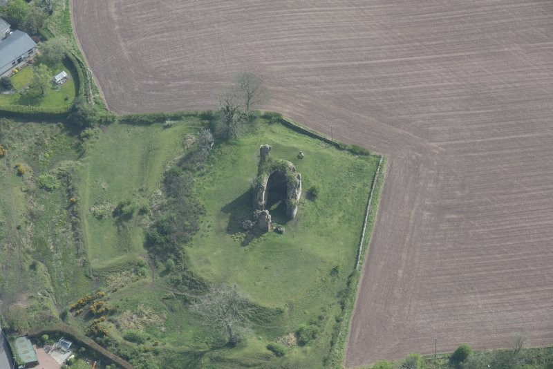 Oblique aerial view of Torthorwald Castle, looking SSE.