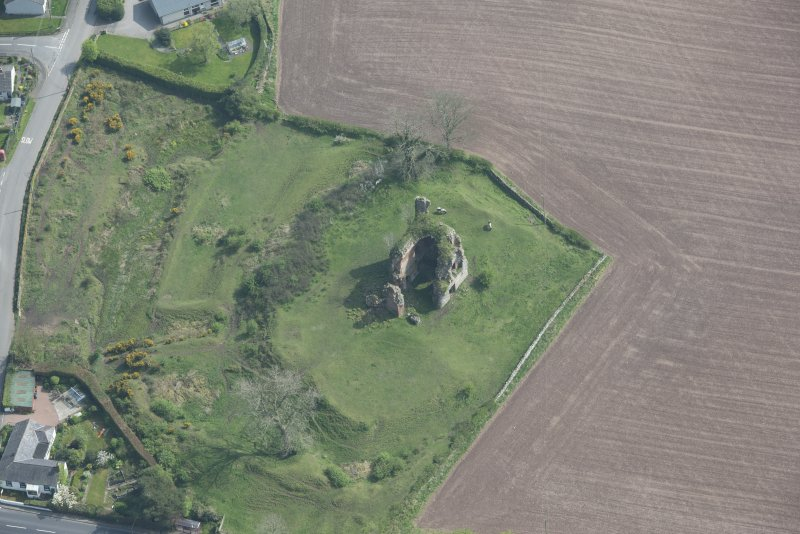 Oblique aerial view of Torthorwald Castle, looking SE.