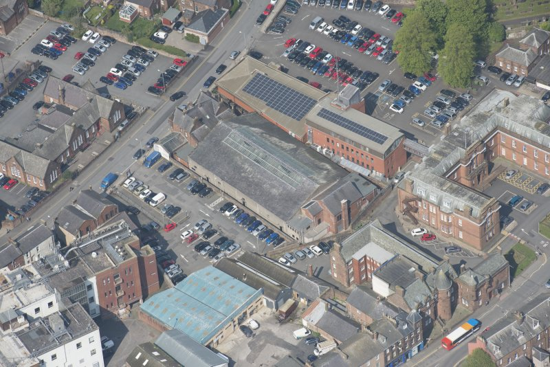 Oblique aerial view of Loreburn Hall Drill Hall, looking NNE.