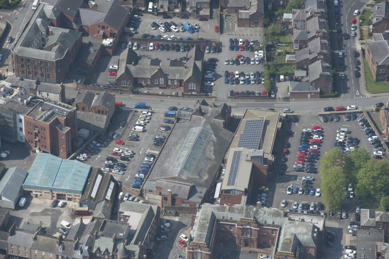 Oblique aerial view of Loreburn Hall Drill Hall, looking NW.