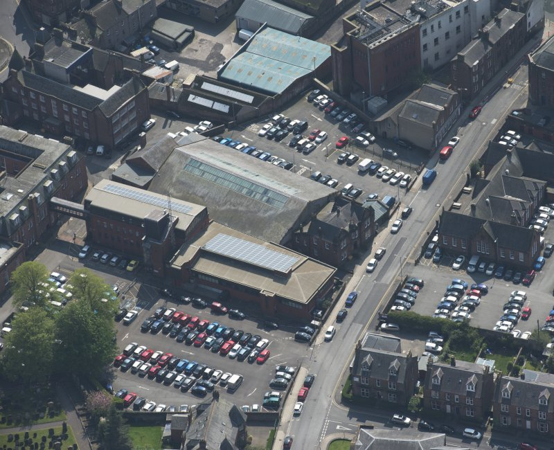 Oblique aerial view of Loreburn Hall Drill Hall, looking SW.