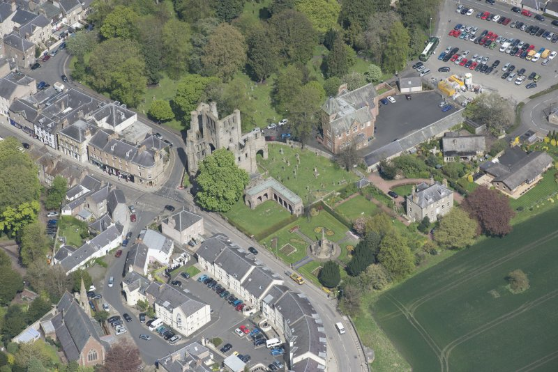 Oblique aerial view of Kelso Abbey and War Memorial, looking NNE.