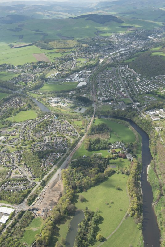 Oblique aerial view of Galashiels, Redbridge Viaduct and construction of the Hawick to Edinburgh Branch Line, looking NW.