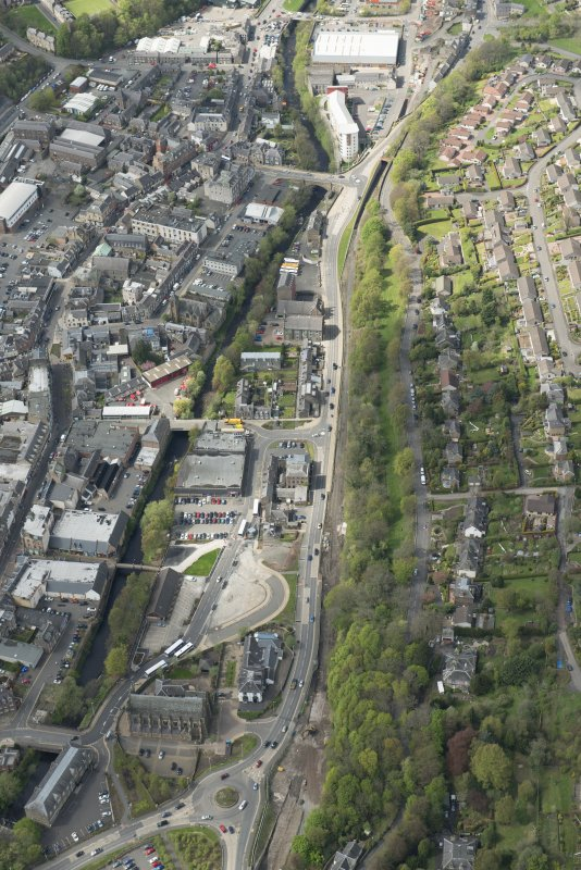Oblique aerial view of Galashiels, and construction of the Ladhope Vale section of the Hawick to Edinburgh Branch Line, looking NW.
