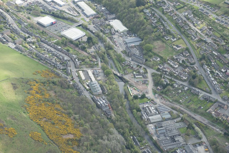 Oblique aerial view of Galashiels, and construction of the Plumtreehall section of the Hawick to Edinburgh Branch Line, looking SSE.
