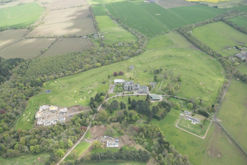Oblique aerial view of Whitehill House and Whitehill Golf Course, looking SE.