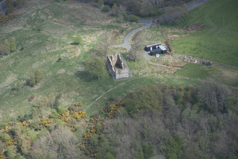 Oblique aerial view of Uttershill Castle, looking E.