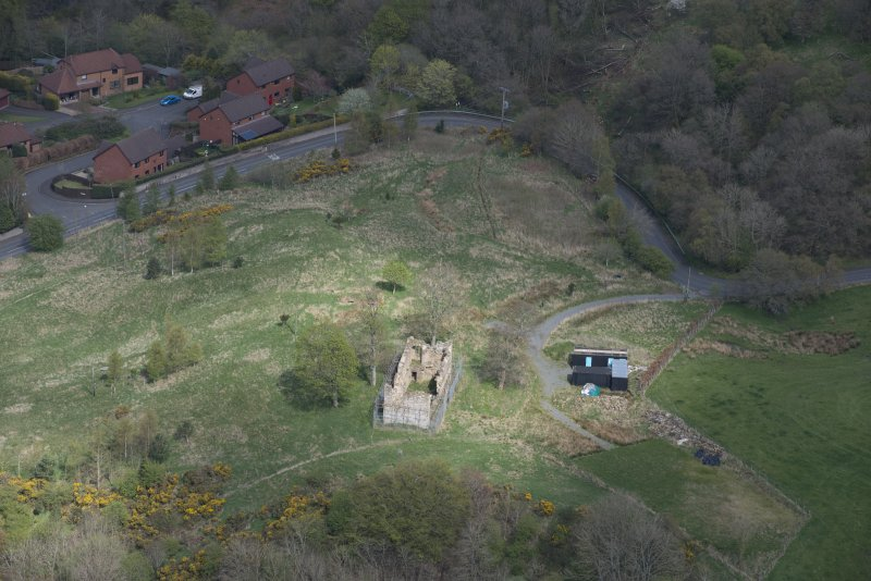 Oblique aerial view of Uttershill Castle, looking NNE.