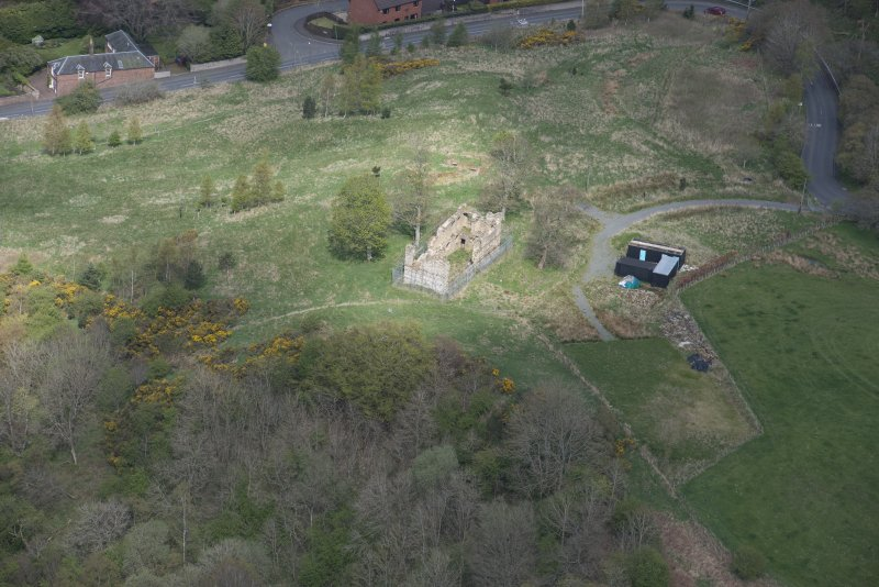 Oblique aerial view of Uttershill Castle, looking N.