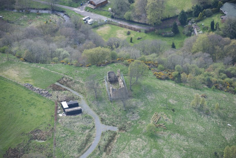 Oblique aerial view of Uttershill Castle, looking SW.