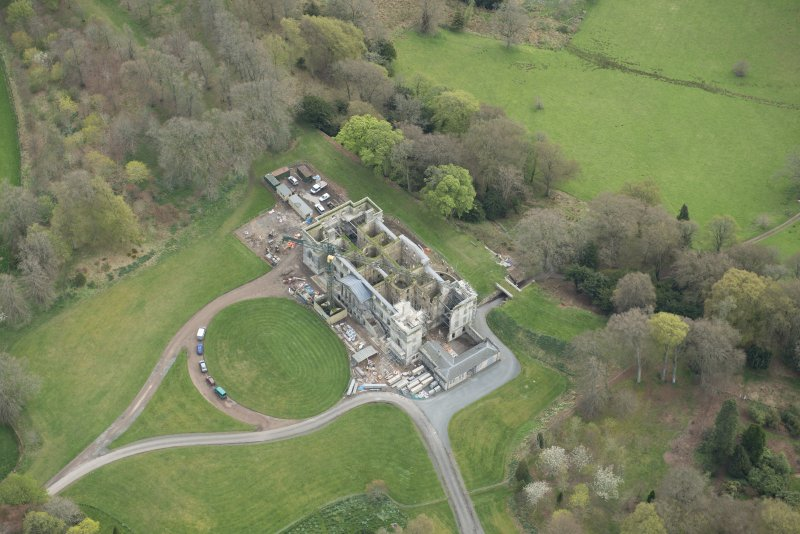 Oblique aerial view of Penicuik House, looking SSE.