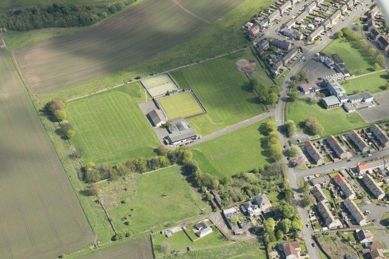 Oblique aerial view of the site of Woolmet House and gateway, looking ESE.