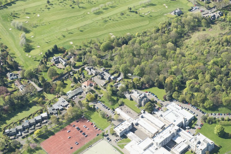Oblique aerial view of Old Ravelston House, Ravelston House walled garden and the Mary Erskine School, looking NW.