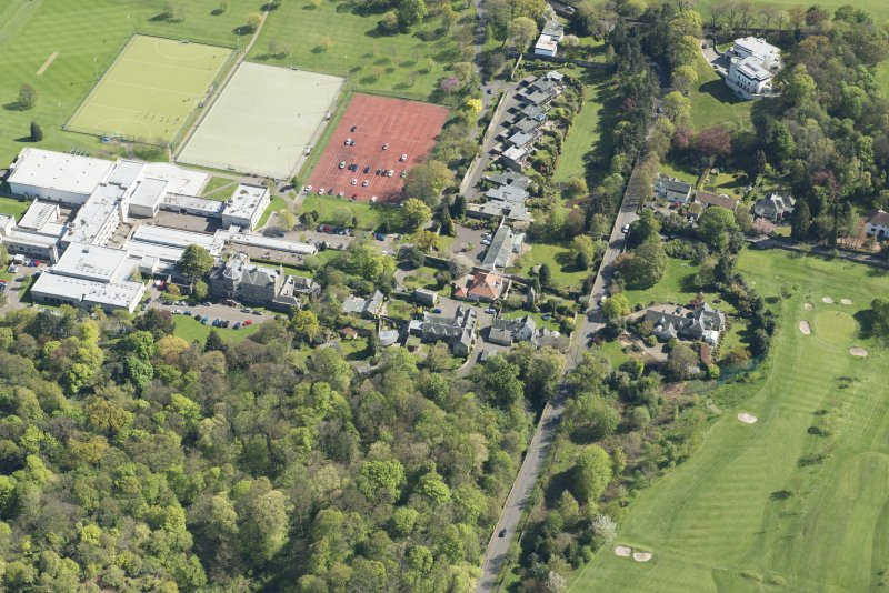 Oblique aerial view of Old Ravelston House, Ravelston House walled garden and the Mary Erskine School, looking SE.