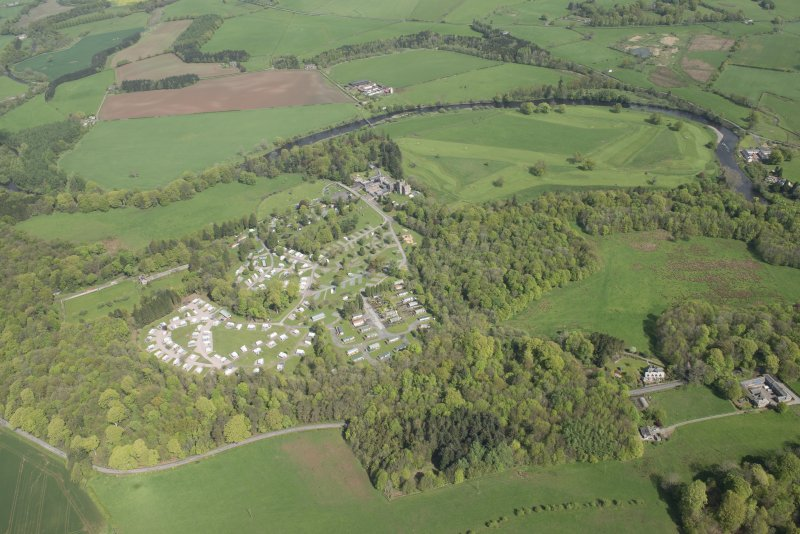 Oblique aerial view of Hoddom Castle and Hoddom Castle Golf Course, looking NNE.
