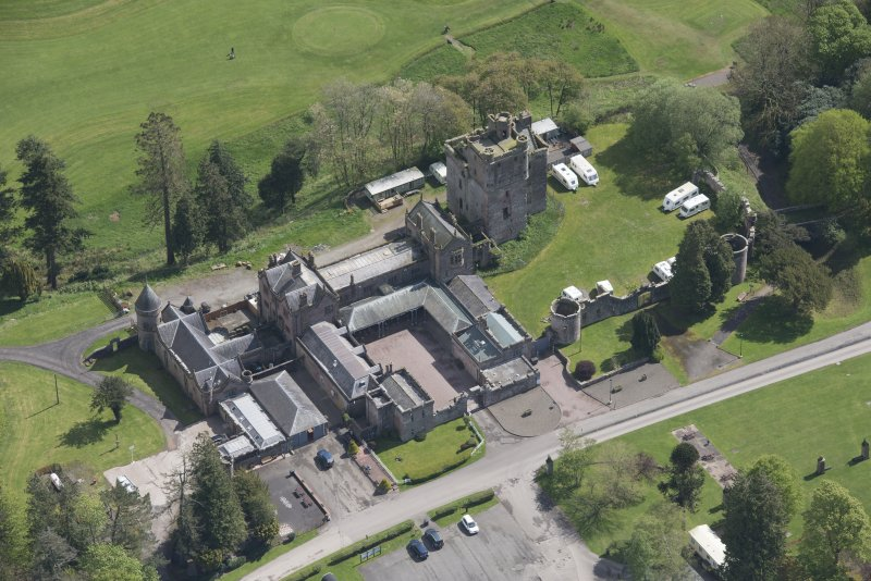 Oblique aerial view of Hoddom Castle, looking E.