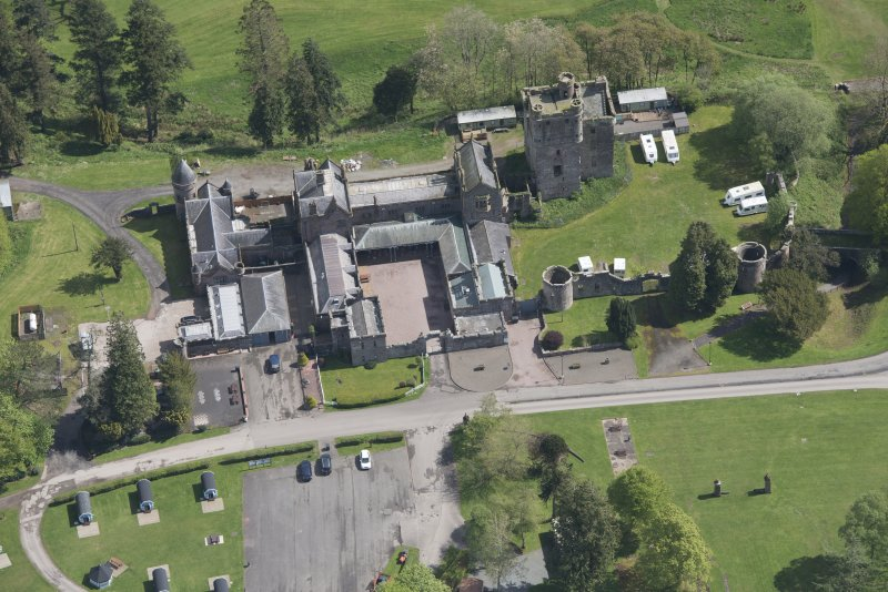 Oblique aerial view of Hoddom Castle, looking ENE.