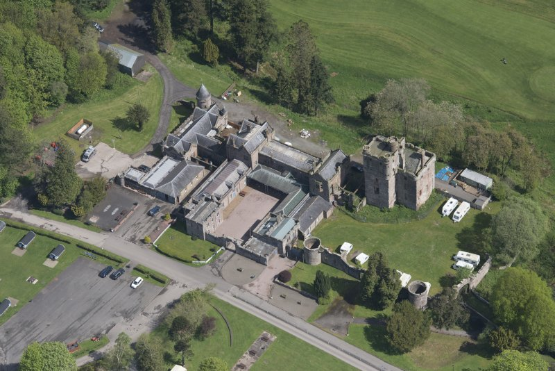 Oblique aerial view of Hoddom Castle, looking NE.