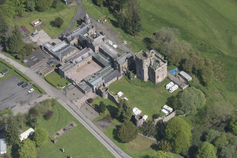 Oblique aerial view of Hoddom Castle, looking NNE.