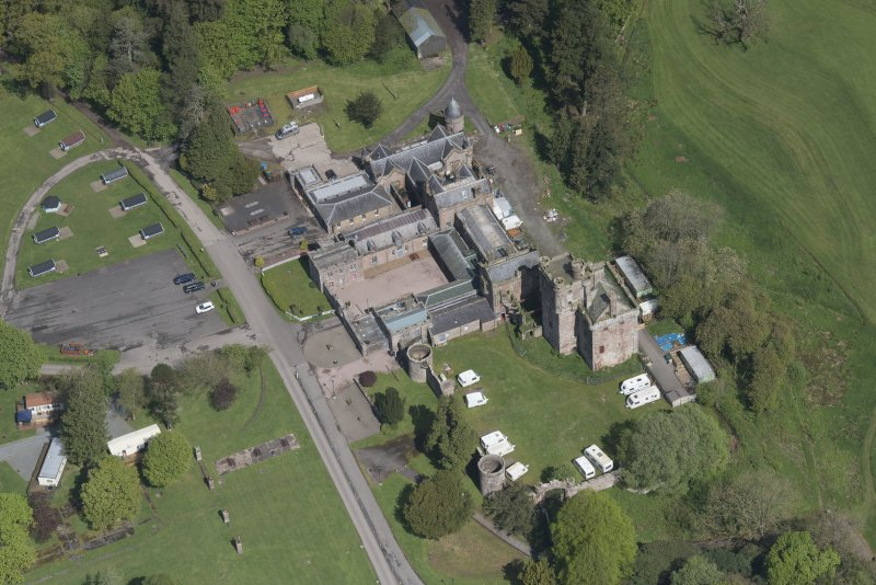 Oblique aerial view of Hoddom Castle, looking NNW.
