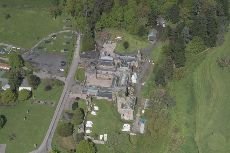 Oblique aerial view of Hoddom Castle, looking NW.