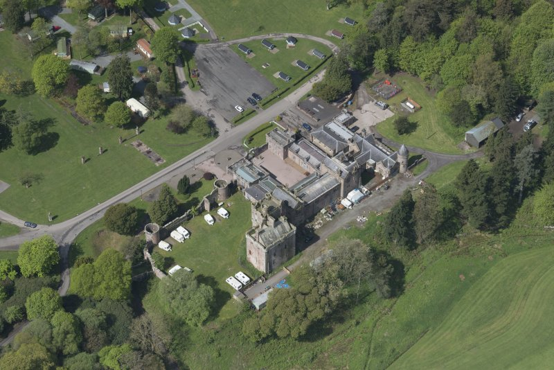 Oblique aerial view of Hoddom Castle, looking WNW.