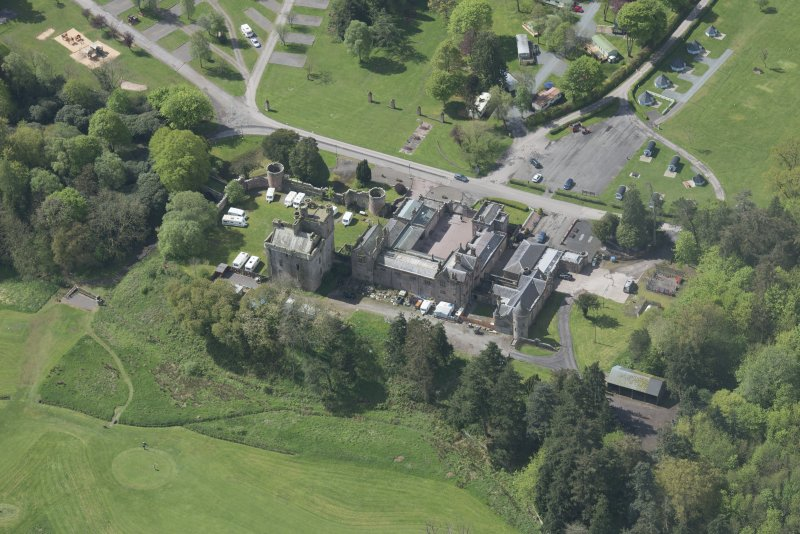 Oblique aerial view of Hoddom Castle, looking SSW.