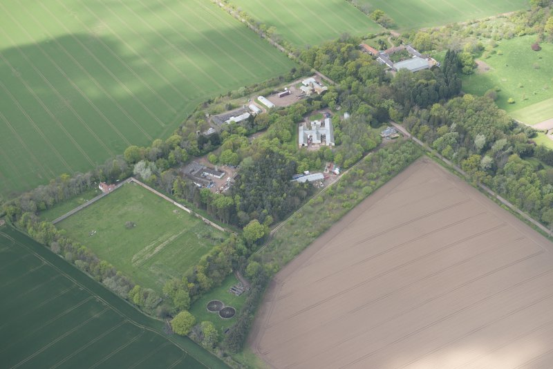 Oblique aerial view of East Fortune Airfield recreation area and Gilmerton House, looking NW.