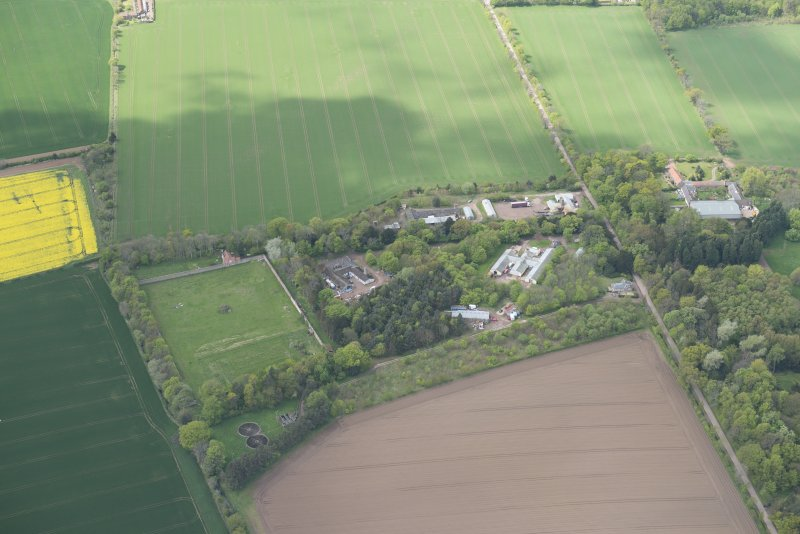 Oblique aerial view of East Fortune Airfield recreation area and Gilmerton House, looking W.