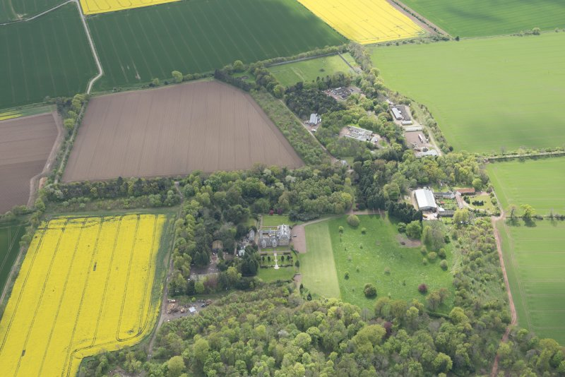 Oblique aerial view of East Fortune Airfield recreation area and Gilmerton House, looking S.