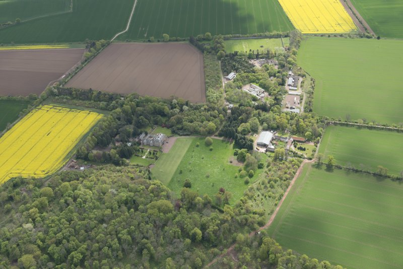 Oblique aerial view of East Fortune Airfield recreation area and Gilmerton House, looking SSE.