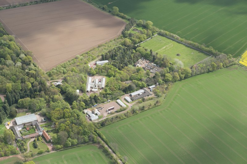 Oblique aerial view of East Fortune Airfield recreation area and Gilmerton House, looking ESE.