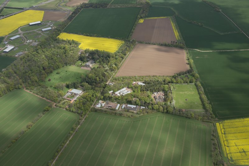 Oblique aerial view of East Fortune Airfield recreation area and Gilmerton House, looking E.
