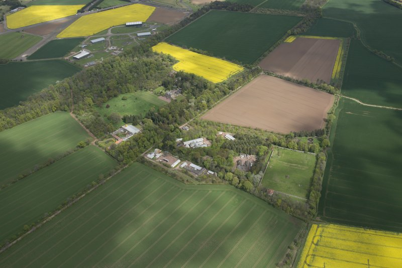 Oblique aerial view of East Fortune Airfield recreation area and Gilmerton House, looking NE.