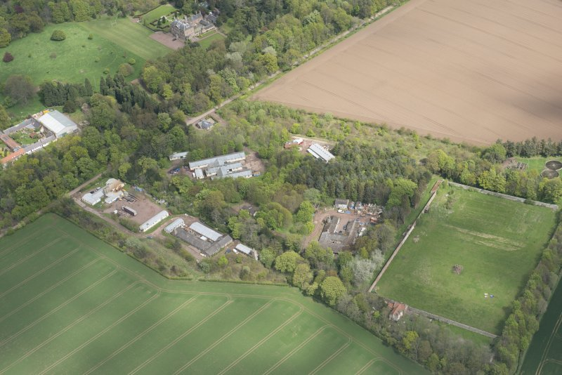 Oblique aerial view of East Fortune Airfield recreation area and Gilmerton House, looking NNE.