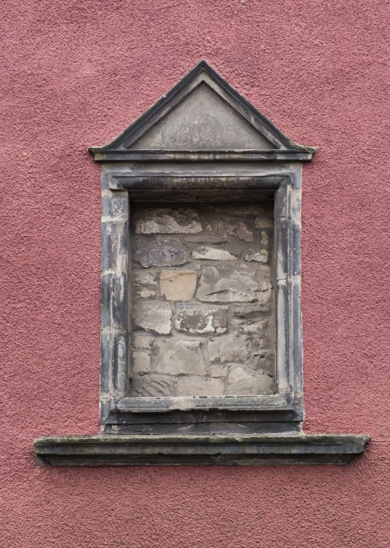 Detail of pedimented blank date panel on front elevation of 124 Canongate, Edinburgh.