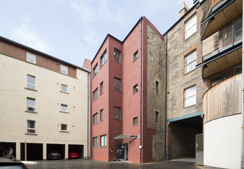 View of rear elevation of 124 Canongate, Edinburgh, from SE.