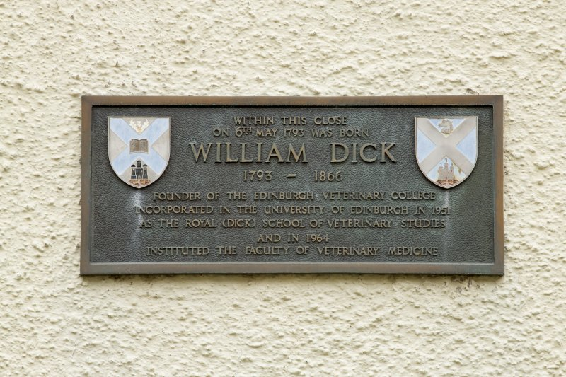 Detail of plaque noting that the founder of Edinburgh Veterinary College, William Dick (1793-1866) was born within 1-12 White Horse Close, 29 Canongate, Edinburgh.
