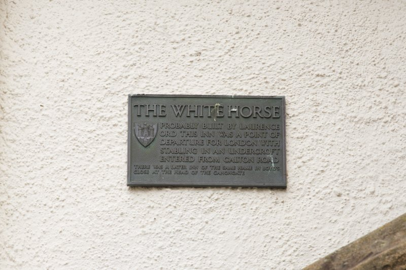 Detail of plaque giving history of 1-12 White Horse Close, 29 Canongate, Edinburgh.