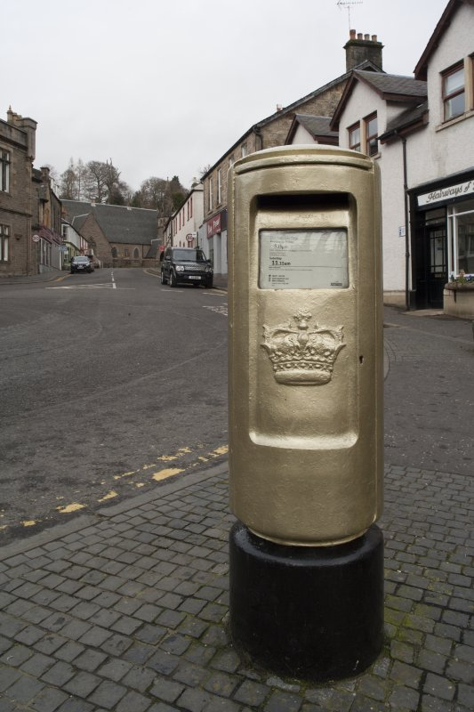 Detail of Royal Mail post box painted gold to commemorate Andy Murray's Gold Olympic Medal in 2012.