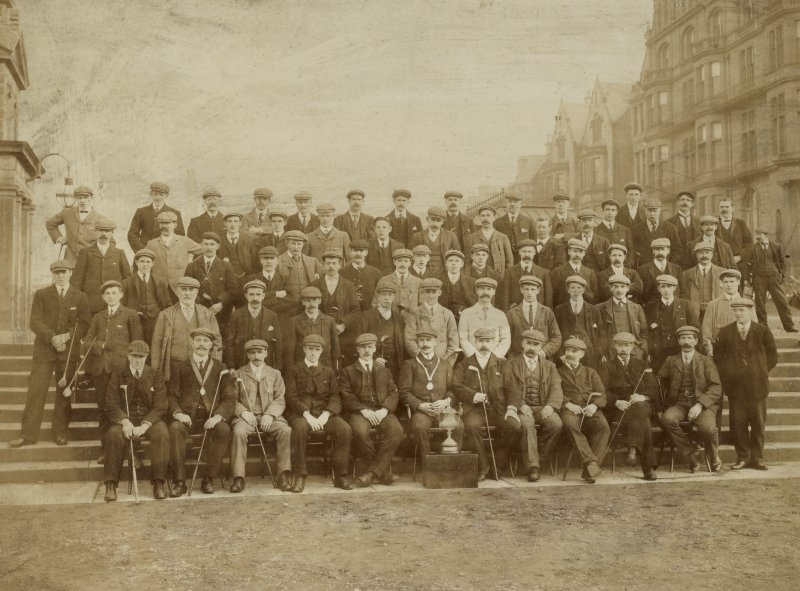 Group photograph of St Andrews Golf Club members outside the Royal and Ancient Golf Club.