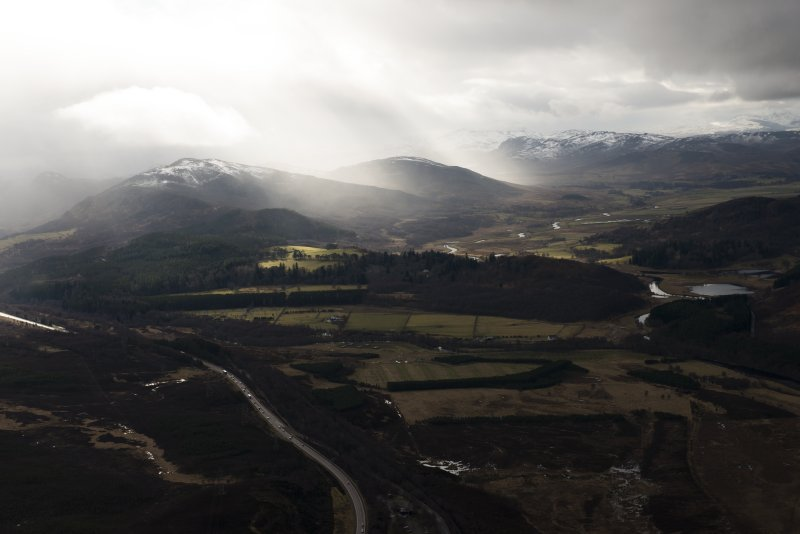 General oblique aerial view of the Invernahavon battlesite at the confluence of the Spey and Truim, looking SW.