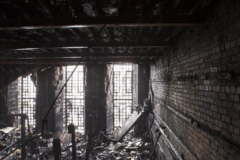 Interior view looking into the fire damaged library of the Mackintosh building.