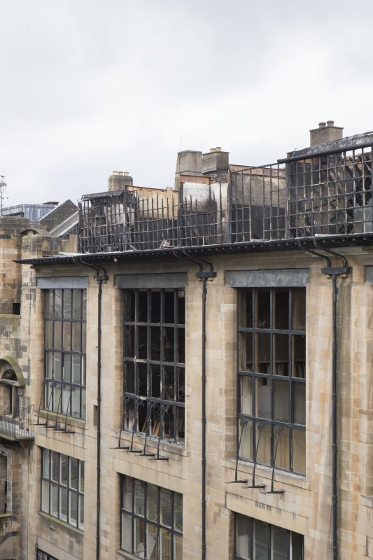 View of the fire damage windows of the first and second floor studios on the north elevation of the Mackintosh building, taken from the north west on the roof of the Bourdon building.
