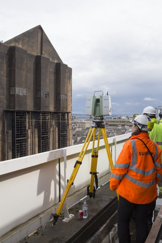 View of the Historic Scotland digital scanning team recording the fire damaged Mackintosh building from the roof of the Bourdon building.
